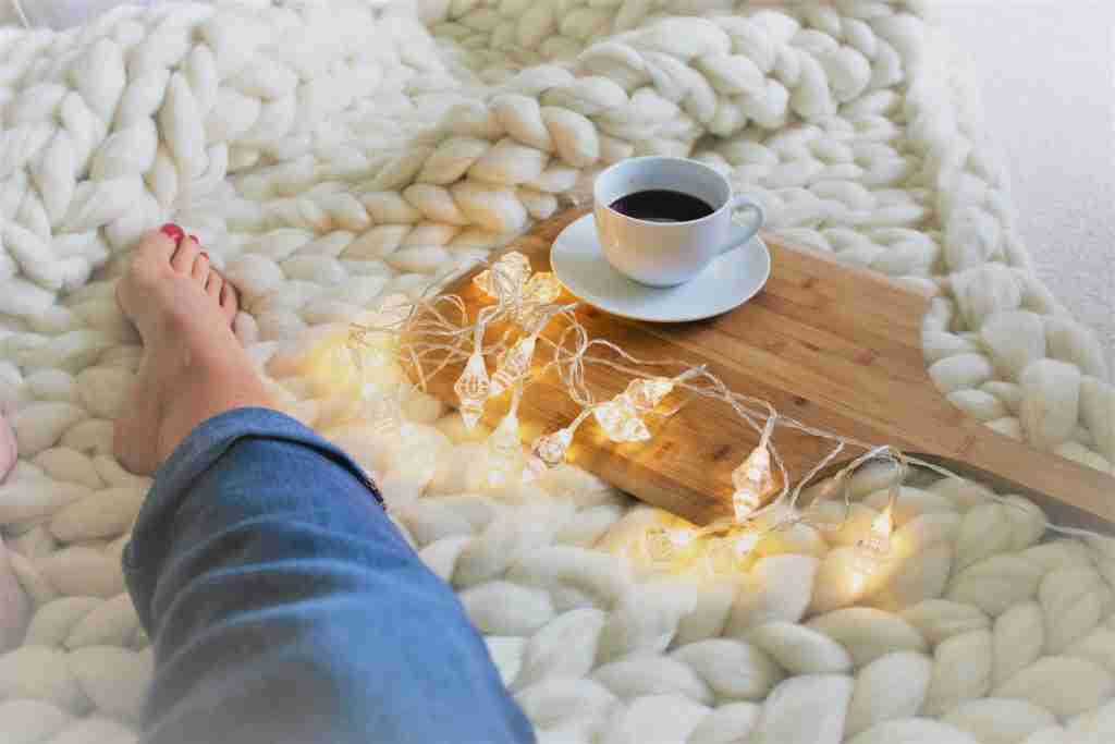 The Best Chunky Knits blanket with coffee and fairy lights